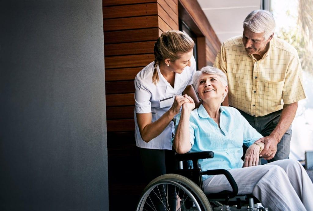 Senior couple in a wheelchair with a SADI nurse