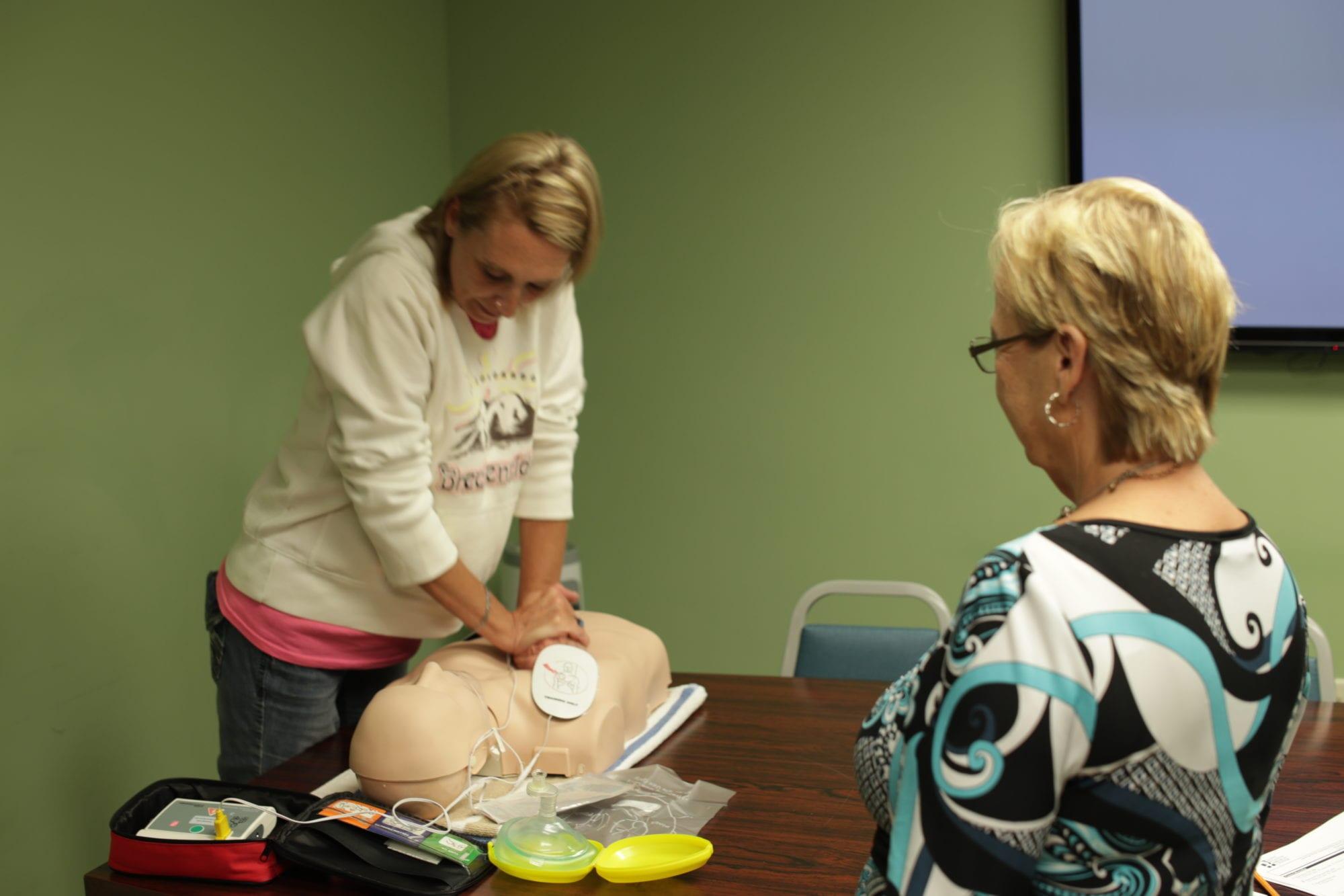 Nurse Cheri teaching CPR at SADI in Missouri