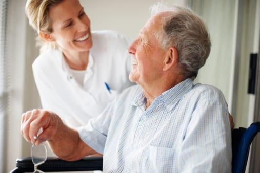 Elderly man speaking to a nurse at SADI in Missouri