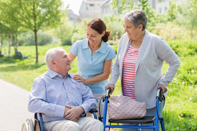 Caregiver from SADI providing assistive living to a senior couple