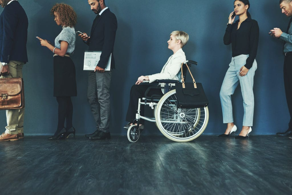 Woman in a wheelchair waiting in line to be interviewed