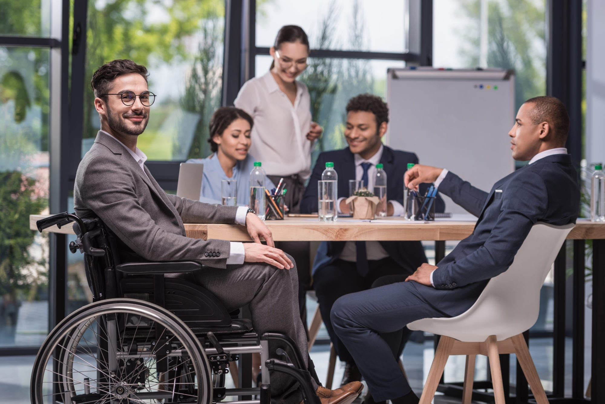 smiling disabled businessman in wheelchair