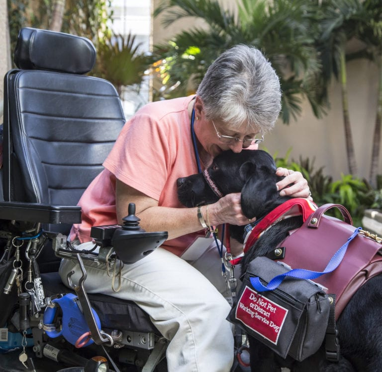 Service dog named Giles and his recipient at Longwood Gardens