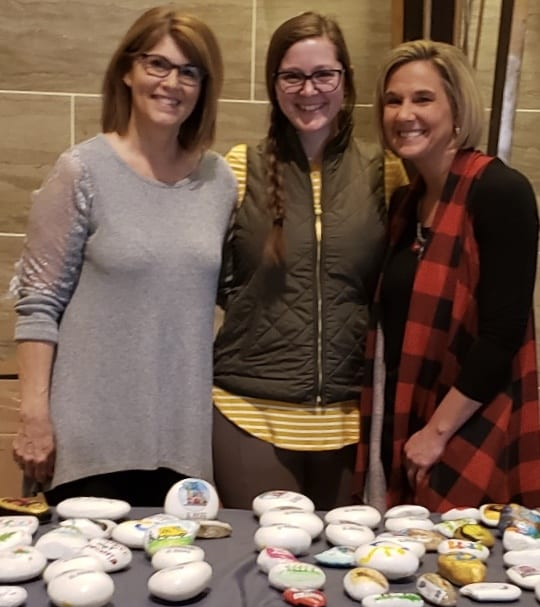 Volunteers Displaying Painted Rocks for IL Rocks, Centers for Independent Living